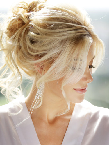 A loose and romantic bridal updo.