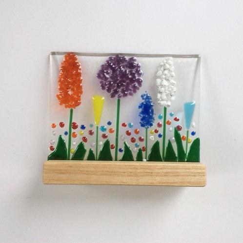 Fused glass mounted garden scene, with oak base, 150 x 125 mm