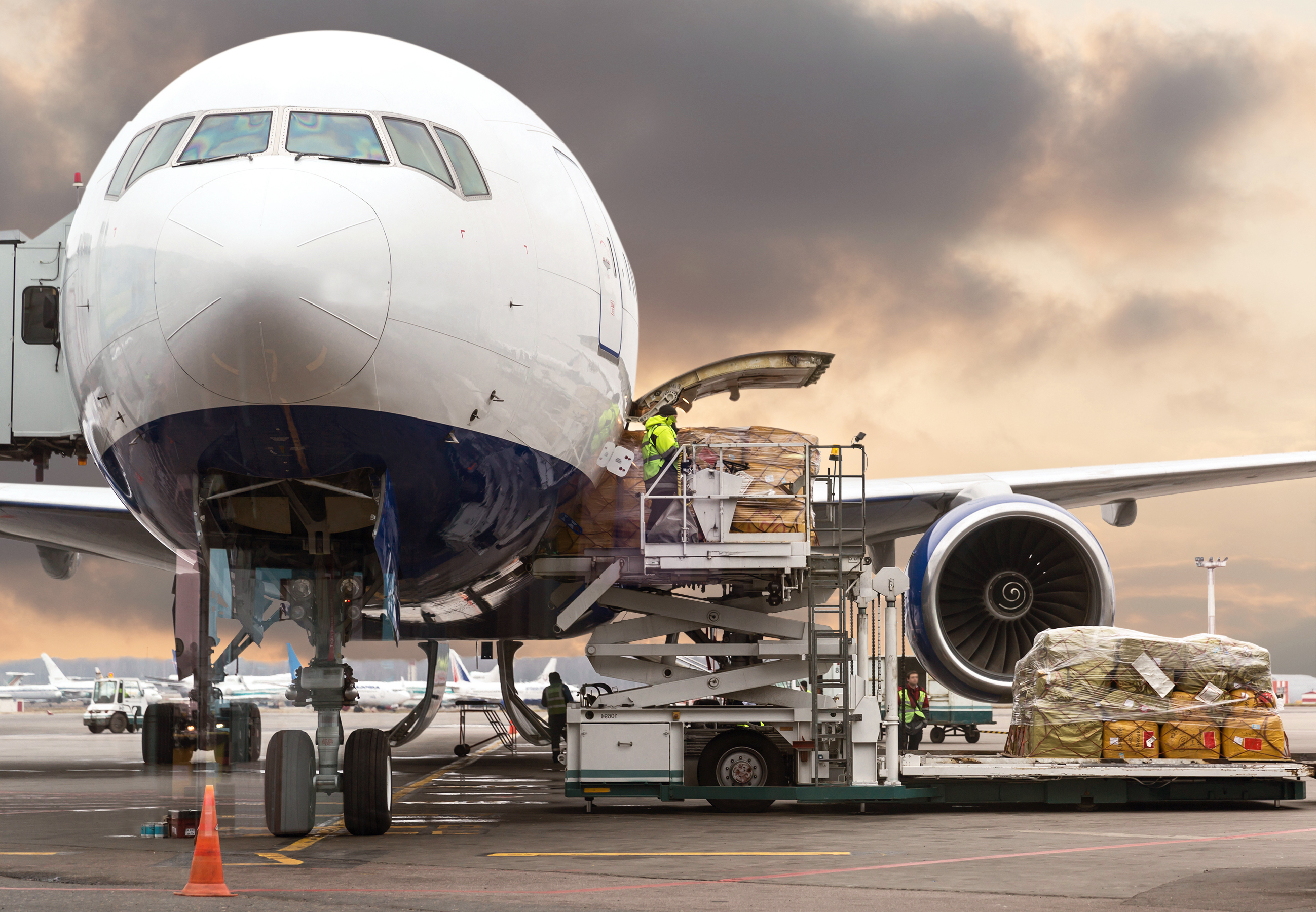 Loading cargo on the plane in airport, v