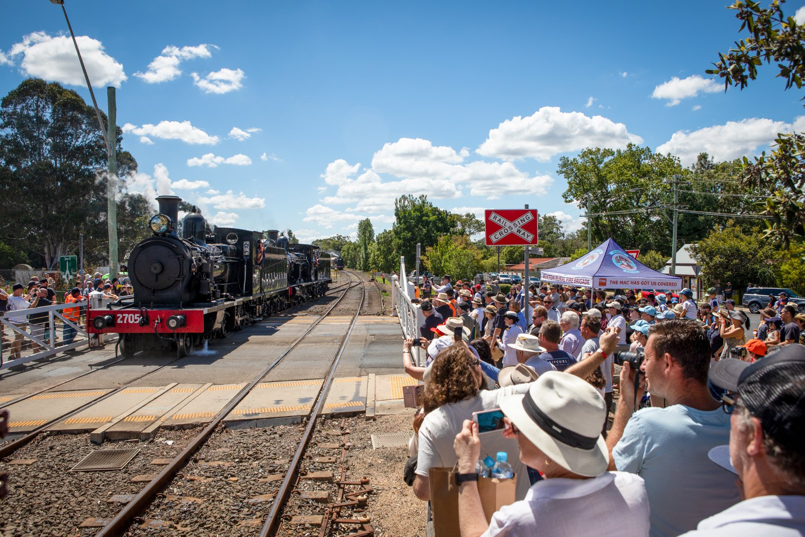 Crowds gather to watch the run around of locomotives 2705 and 3265. -Trys Eddy Photos
