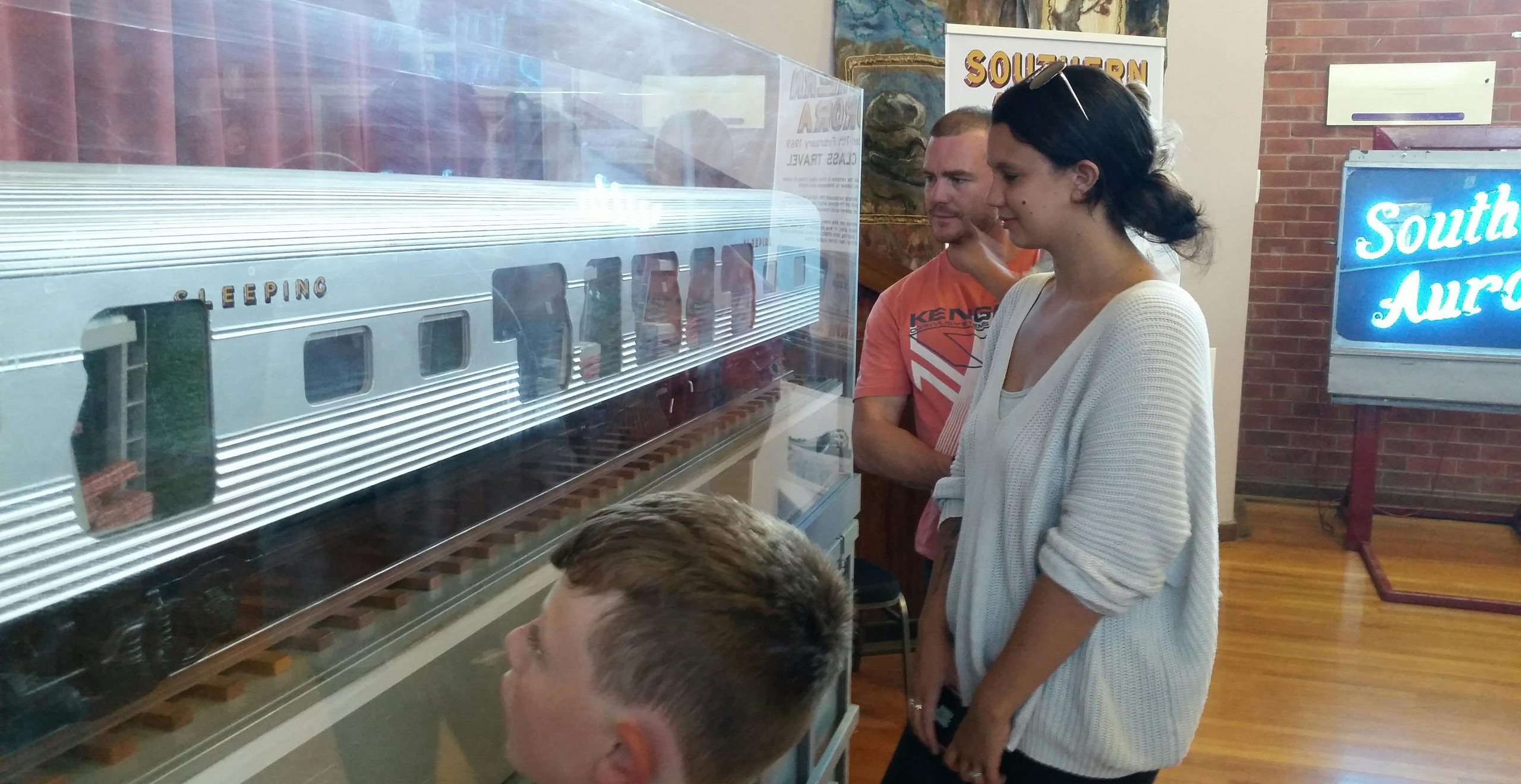 Visitors enjoy viewing the sectioned large-scale model of the Southern Aurora sleeping car on display at the Violet Town Community Complex. -Chris Fielder