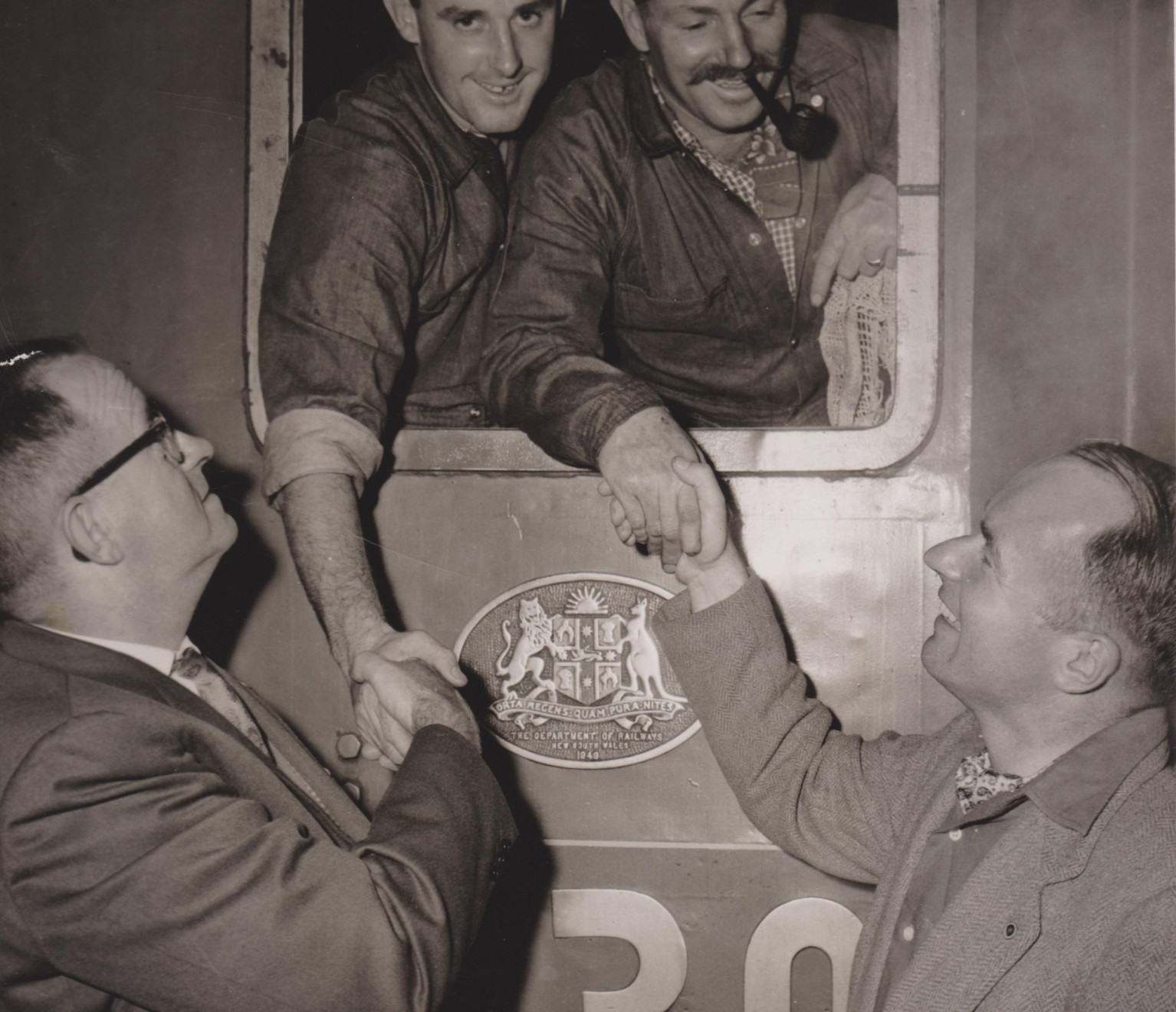 Fireman David Thurlow (left) and driver Chris O'Sullivan (right) in the cab of 3830 at Sydney Terminal, shaking hands with the two ARHS organisers on the successful and on-time completion of the delivery run of the Spirit of Progress. -C. Cardew, Dave Thurlow Collection