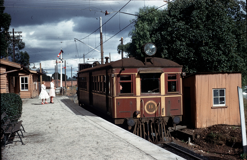 Railmotor CPH 11 pauses at Camellia Station during 1959 to pick up two passengers. Australian Railway Historical