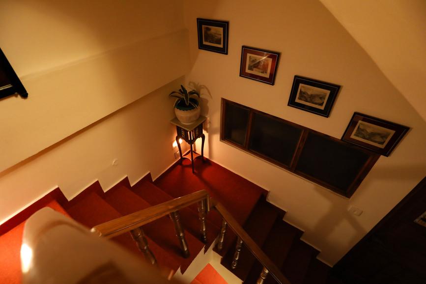 The beautiful winding wooden stairway