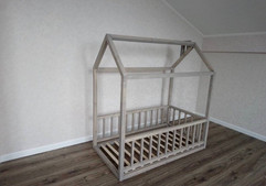 House bed with rails and mattress off the floor