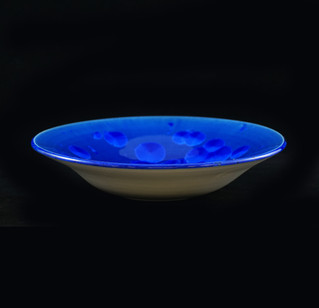 Bowl, exterior porcelain clay, interior vibrant bleu crystalline glaze