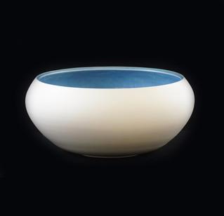 Bowl,  exterior white porcalain clay, interior spotted denim blue glaze