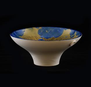 32) Vessle, exterior porcelain clay, interior amber/blue  crystalline glaze