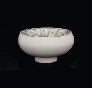 Vessle, doubble walled, exterior white stoneware, interior beige w black/green/blue spots glossy glaze