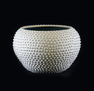 21) Bowl, exterior  white stoneware, altered surface, interior green semi matte glaze.