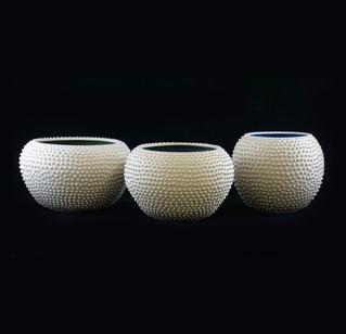 54) Vessle, white stoneware, altered surface, interior green, blue glossy glaze