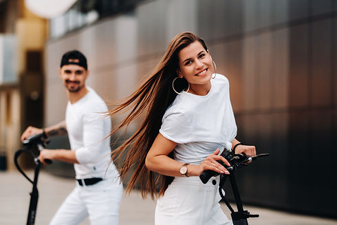 girl-and-guy-are-walking-on-electric-sco