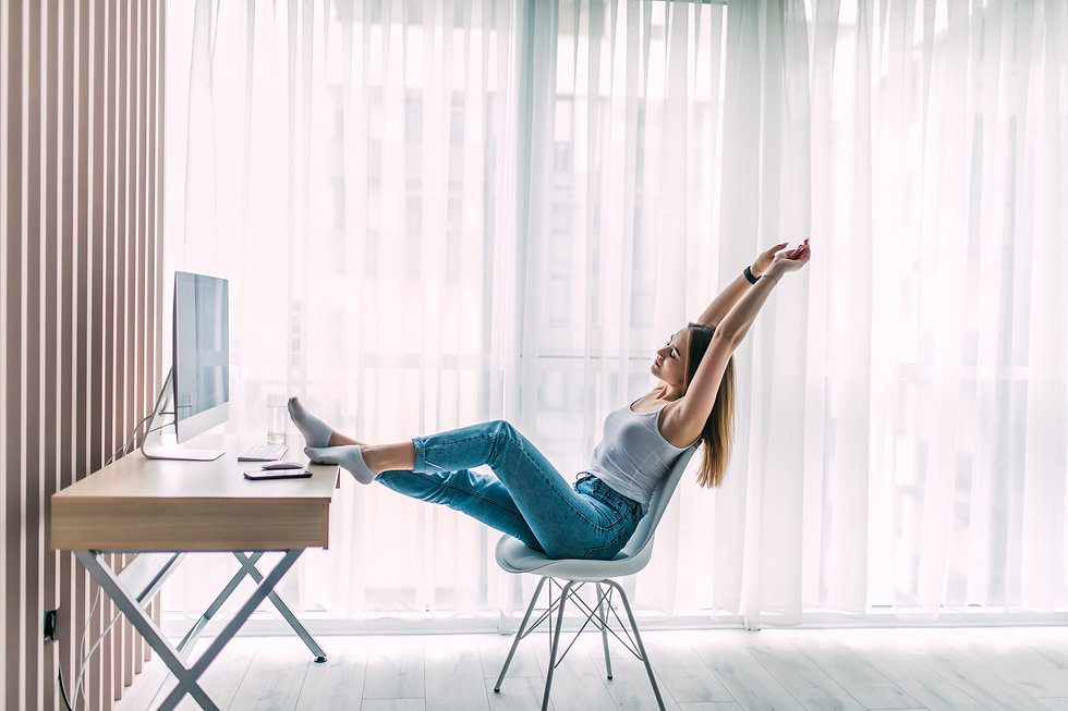 young-female-freelancer-stretching-and-r