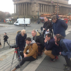 Clients filming a documentary on location as part of a filmmaking course.