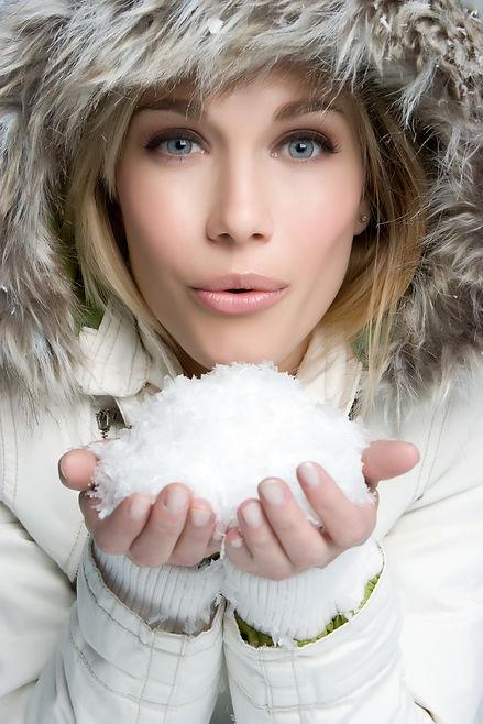 Woman Blowing Snow.jpg