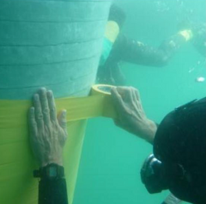 Underwater application of STOPAQ intermediate layer PVC-Yellow. Corrosion prevention impermeable to water and air