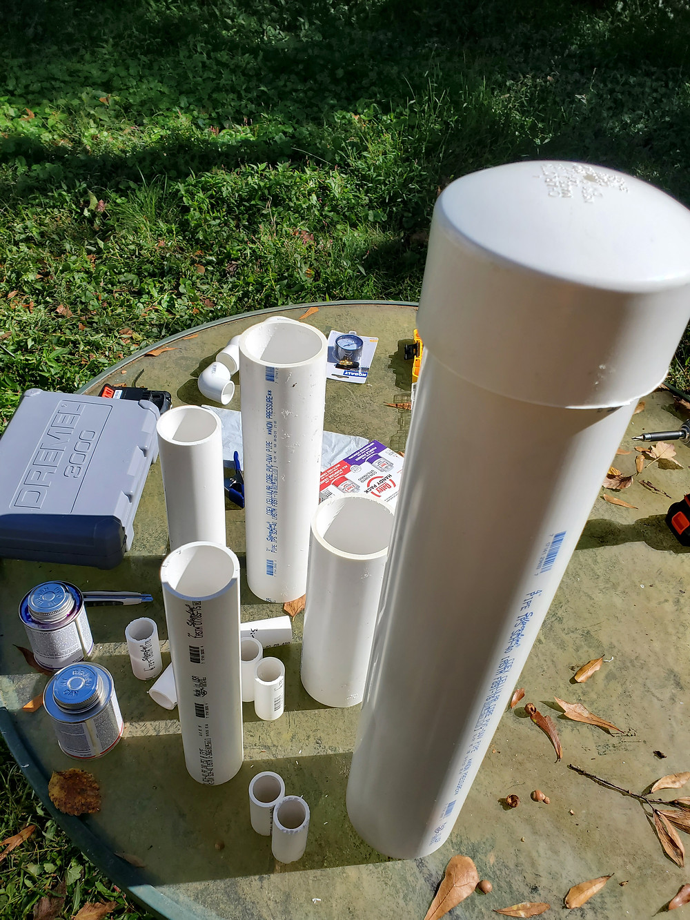 Several lengths of cut PVC pipe, one with an end cap in place