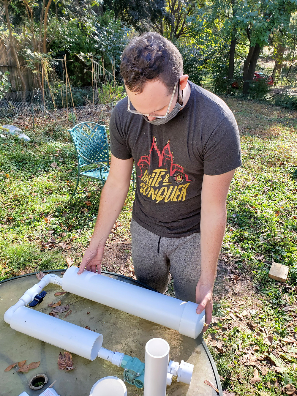Man assembling PVC pipe to test for size and fit