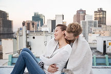 Couple Cuddling on a Rooftop