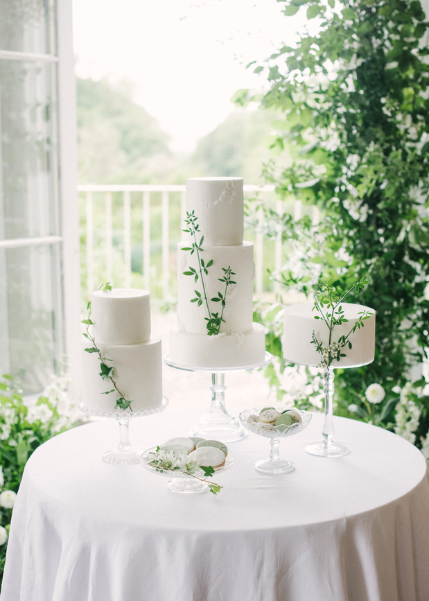 Green and white wedding cake table