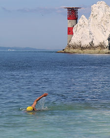 Sea swimmer with lighthouse in the background