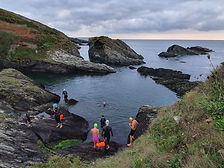 Swimmers entering a rock pool