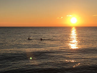 Swimmers with sunset