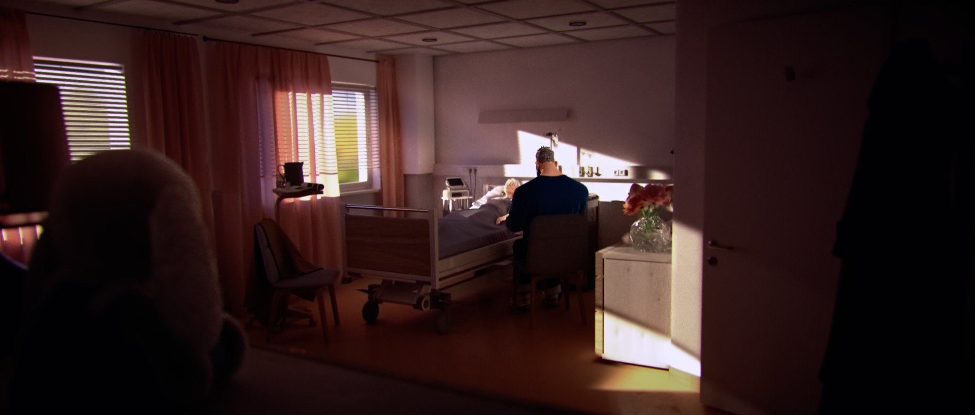 In the hospital we can finally see the two characters together. The father continues to watch over Emily with tenderness and despair when there's a startle in Emily's eyes.