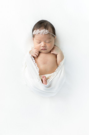 purely posed newborn pictures in Houston
