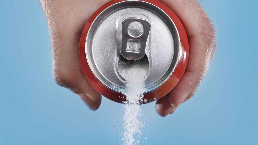 sugar being cured from a soda can