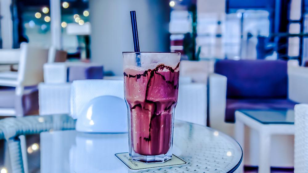 Pink milkshake on a table
