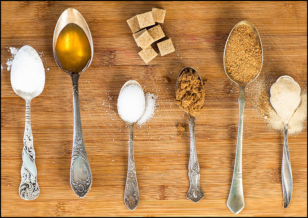 different types of sugars on spoons