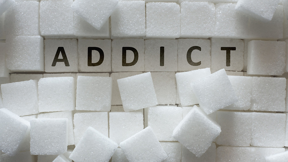 sugar cubes spelling the word addict