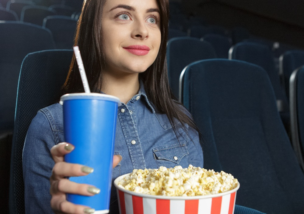 woman preparing to watch a movie