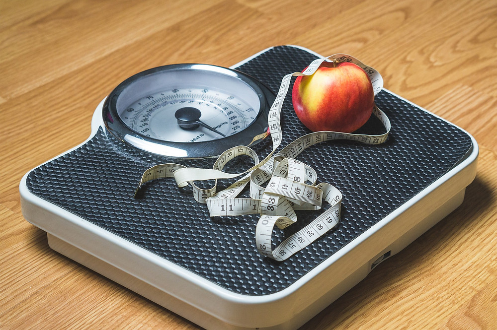 weighing scales and tape measure