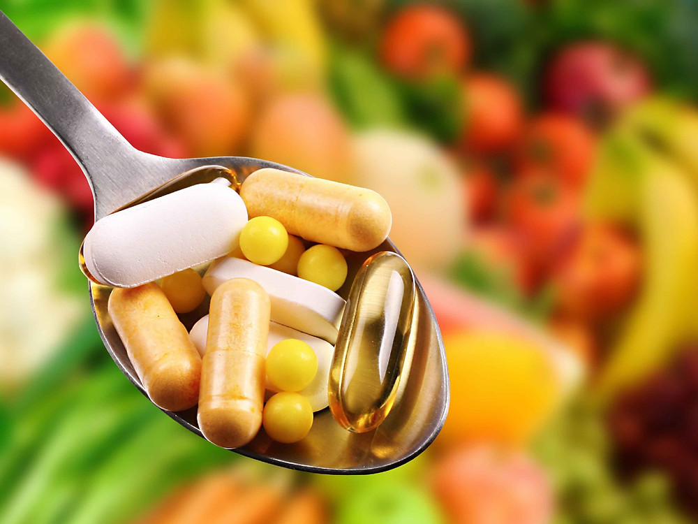 Spoonful of vitamin tablets