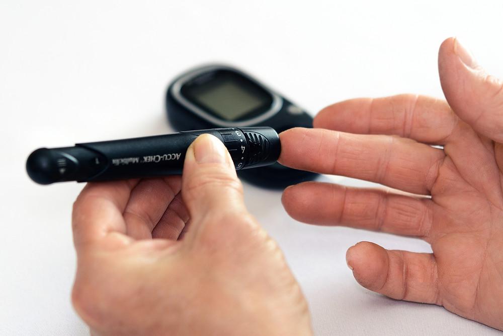 Man taking a blood sugar reading