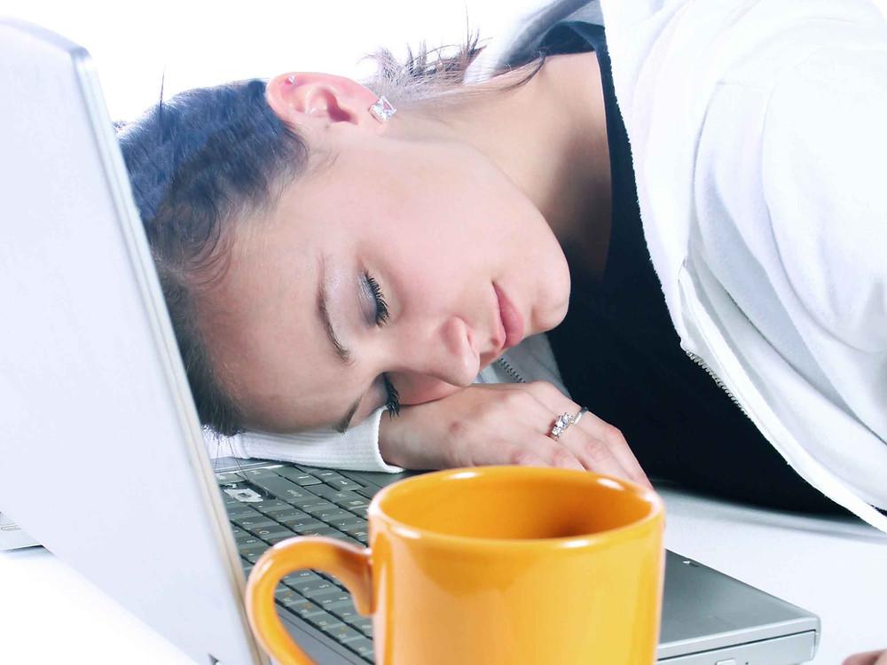 woman asleep at her computer