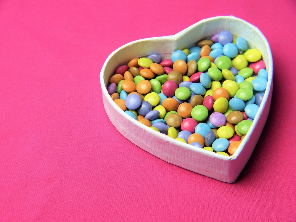 Heart shaped bowl of sweets