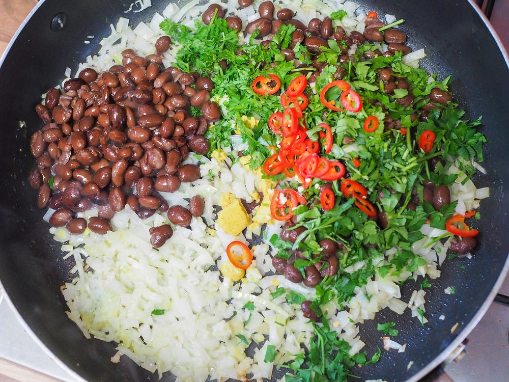 fried black beans in pan