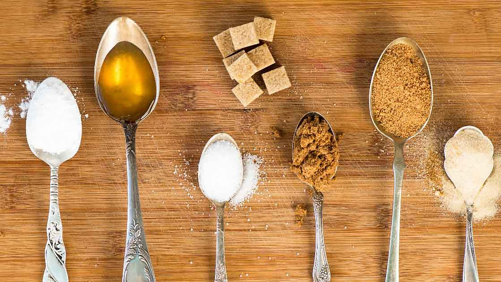 different types of sugar on spoons