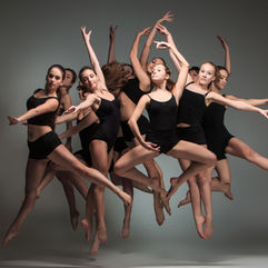 Event photography: Group of dancers performing a ballet routine at a launch event in Dubai.