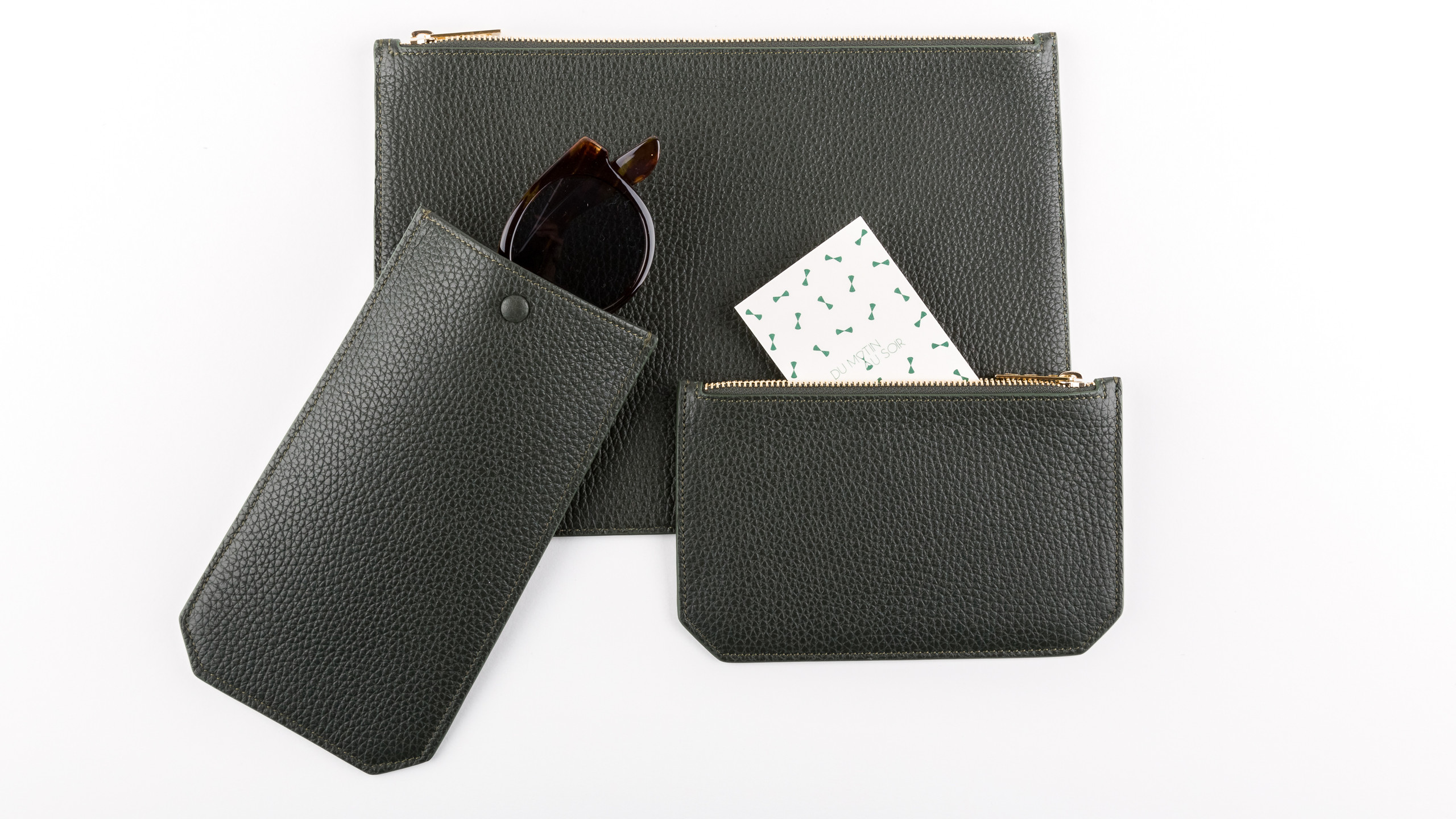 Pine green grained leather pouches