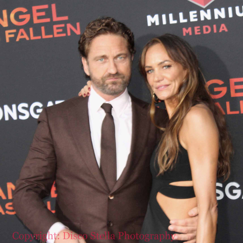 Gerard Butler with lady guest 5
