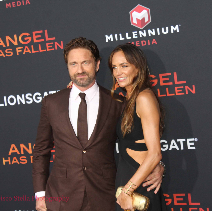 Gerard Butler with lady guest 7