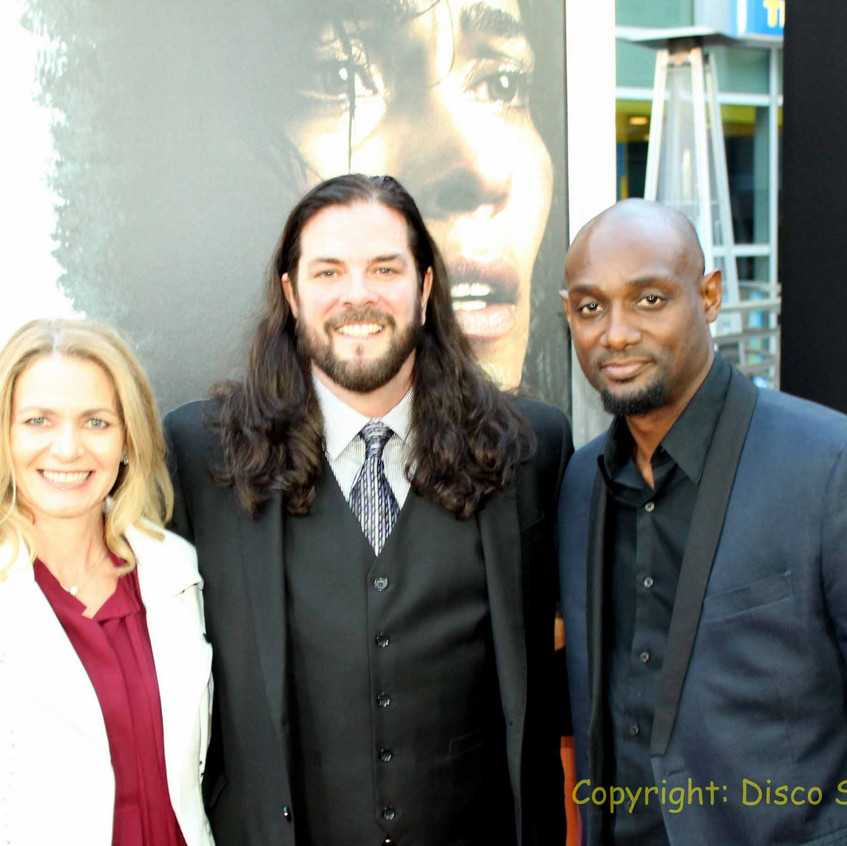 Scott Anthony Leet- Traffik Cast - Actor at middle with guests
