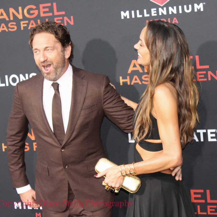 Gerard Butler with lady guest 4