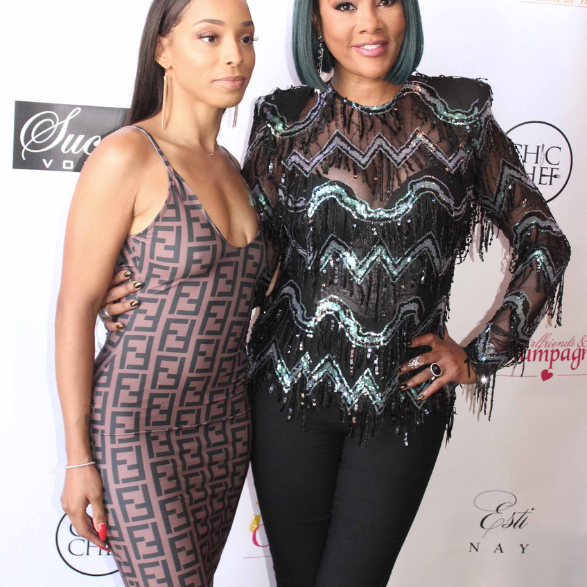Vivica Fox with guest at party