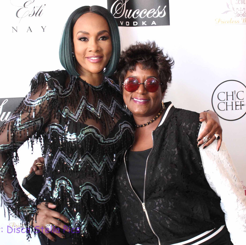 Vivica Fox with guest attending on carpe