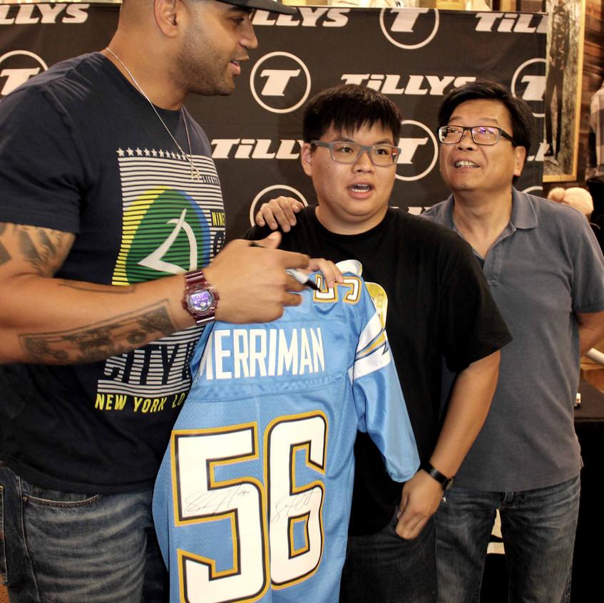 Shawne Merriman with fans 4